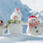 Happy snowmans in mountain
